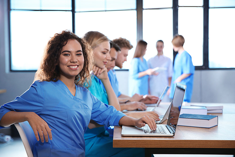 A group of nurses in a continuing education class to accompany an article about continuing education for nurses
